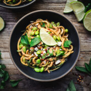 overhead view of zucchini noodles with almond butter sauce in bowl