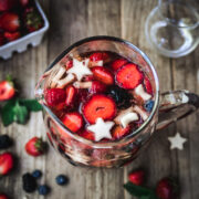 overhead view of red, white and blue sangria in pitcher