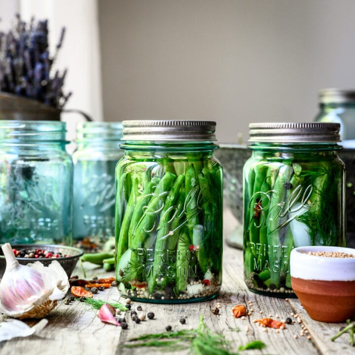 pickled dilly beans in blue ball jar