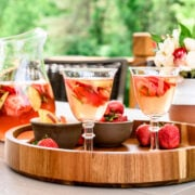 Side view of two glasses of strawberry peach sangria