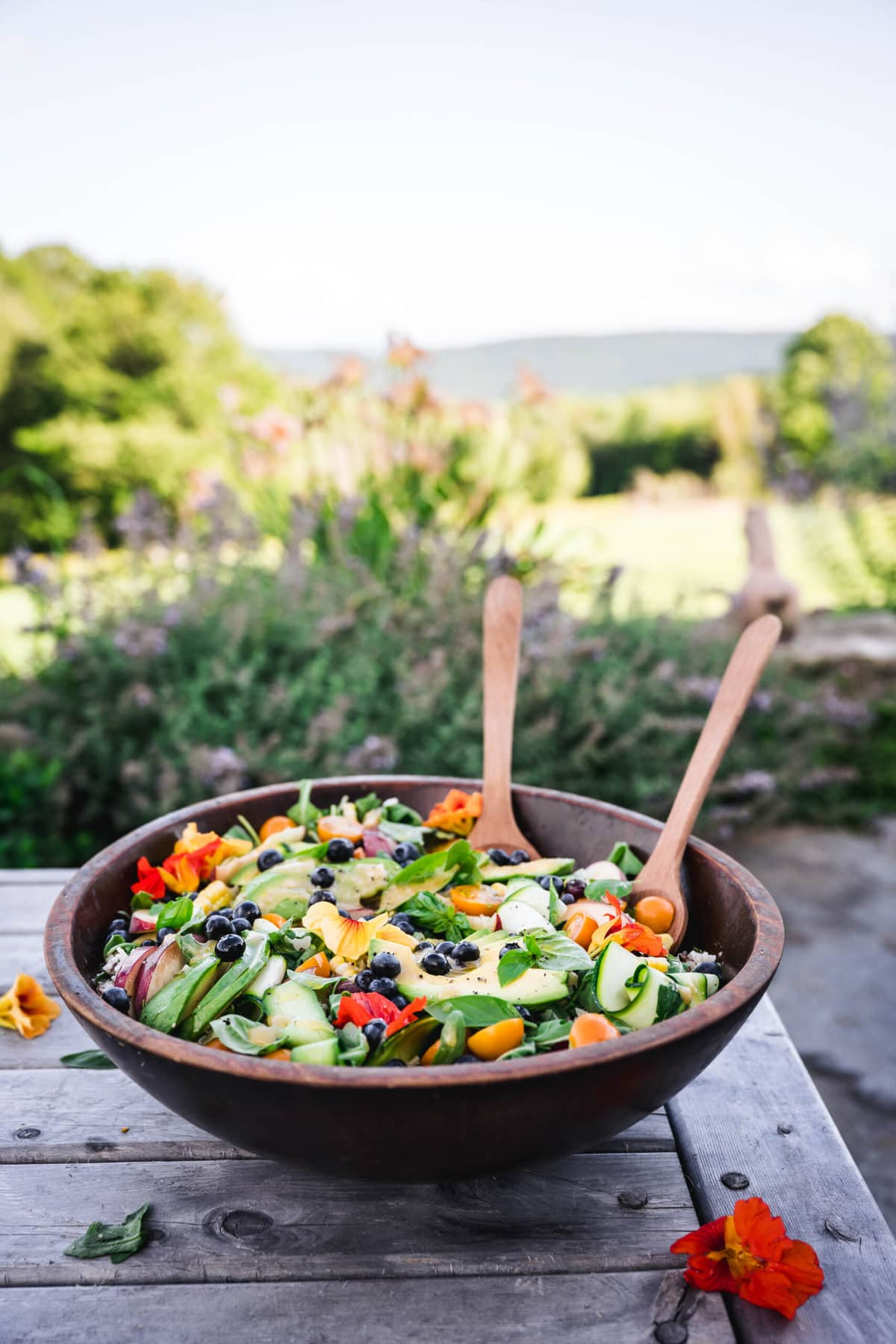 side view of summer dinner salad on outdoor table