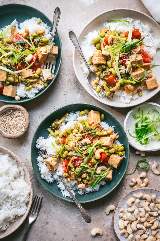 vegan teriyaki tofu vegetable stir fry in bowls