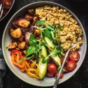 overhead view of savory vegan breakfast bowl with potatoes and scrambled tofu