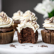 side view of vegan chocolate cupcake with bite taken out