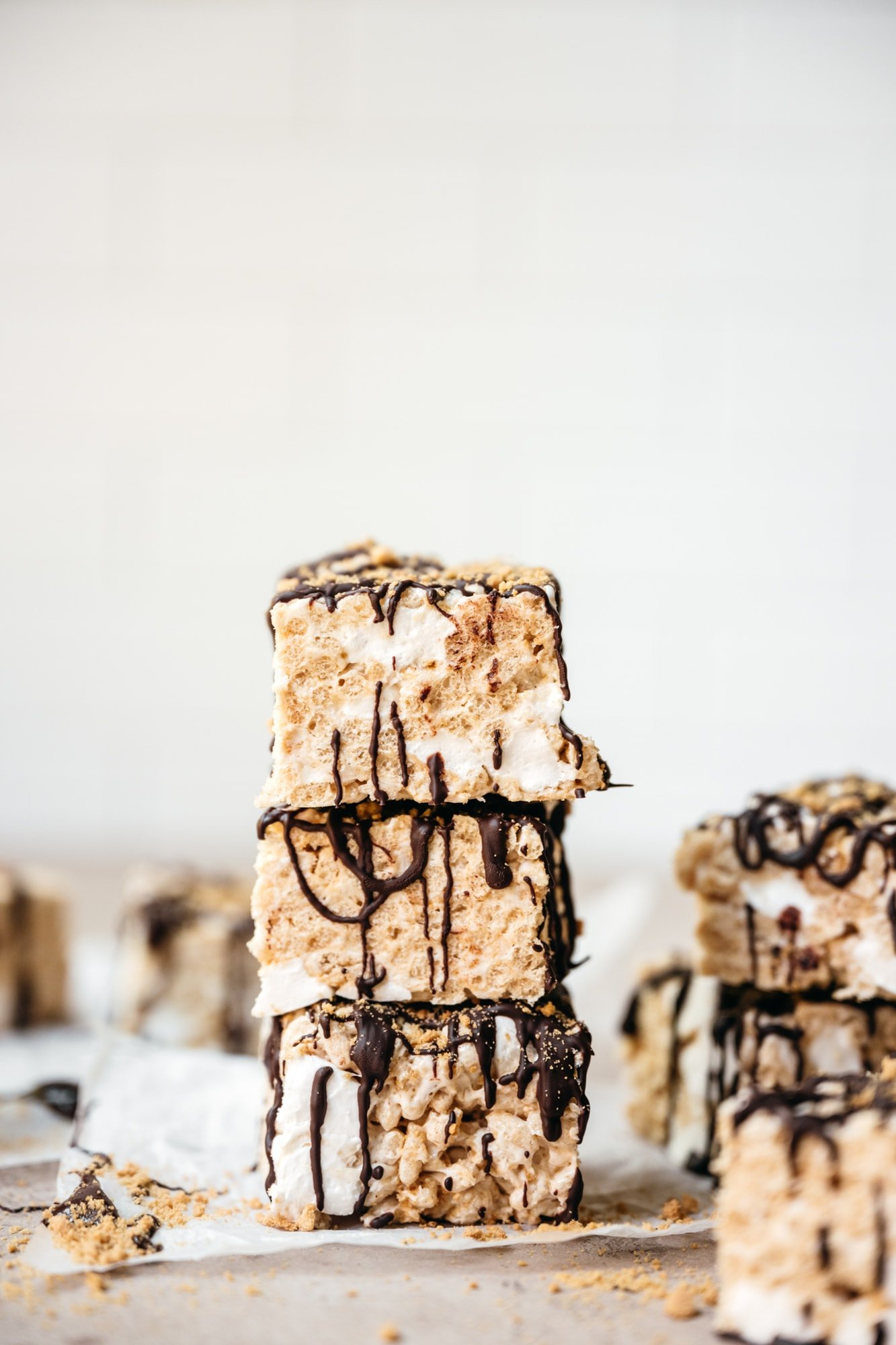 side view of stack of rice krispie treats with chocolate