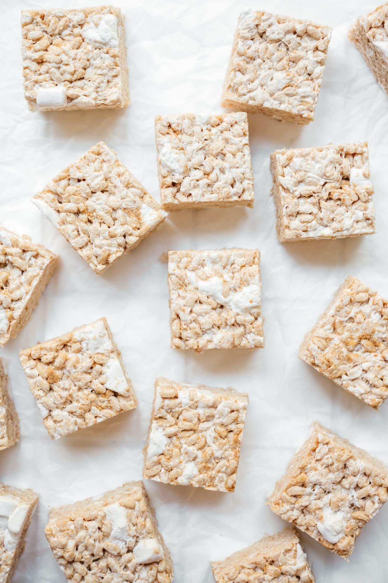 overhead view of plain vegan rice krispie treats on parchment paper