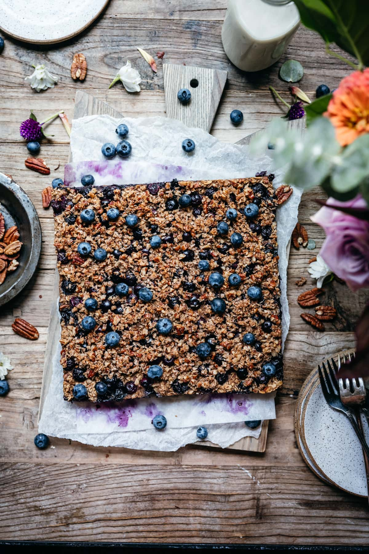 overhead view of vegan blueberry baked oatmeal on wood cutting board