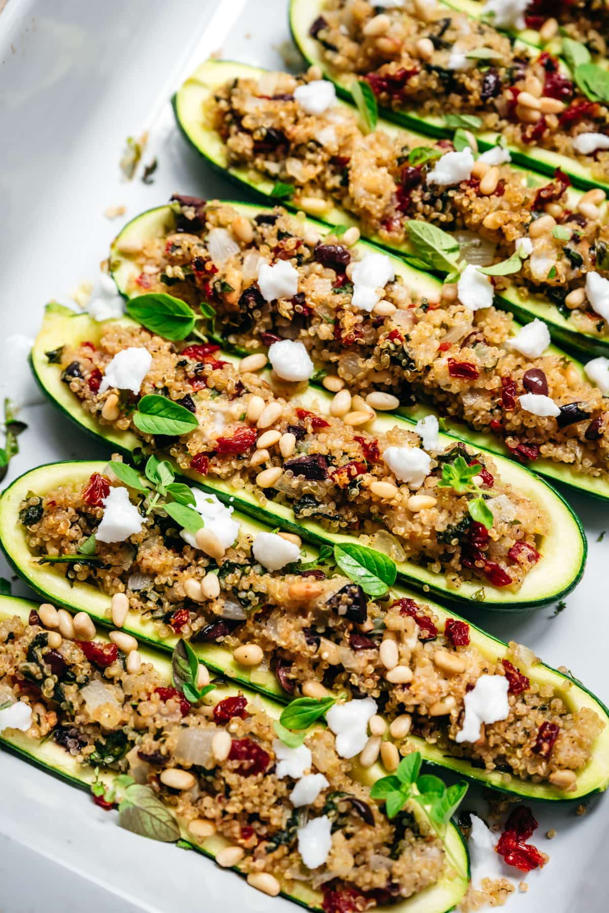 side view of quinoa stuffed zucchini boats in pan