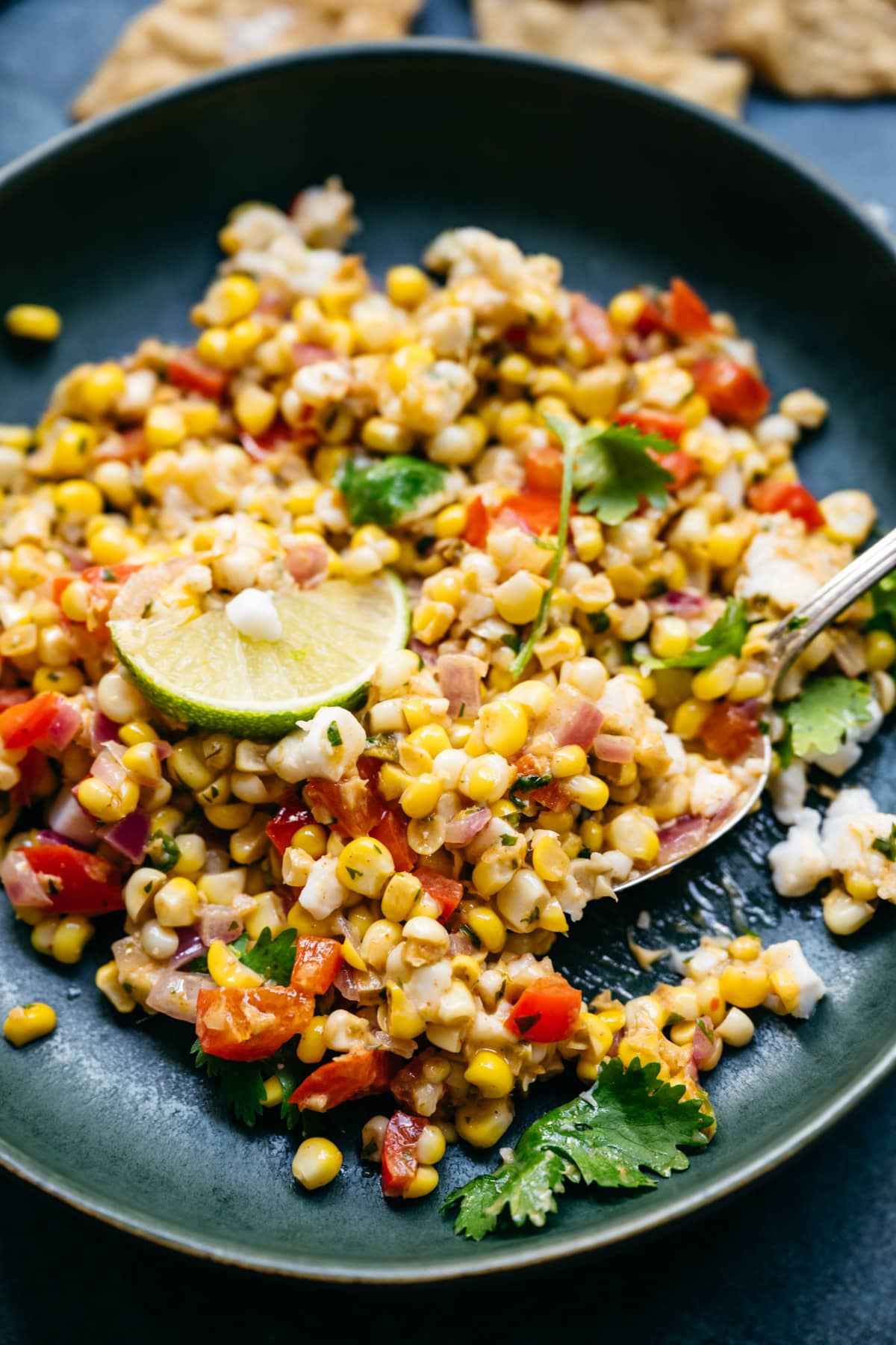 close up view of vegan corn salad in a bowl