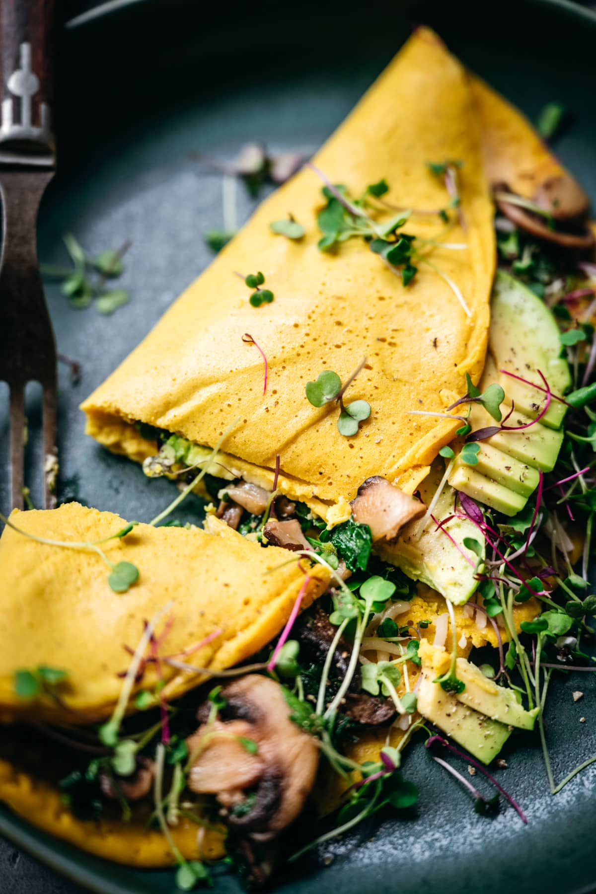 close up view of vegan omelette cut in half.