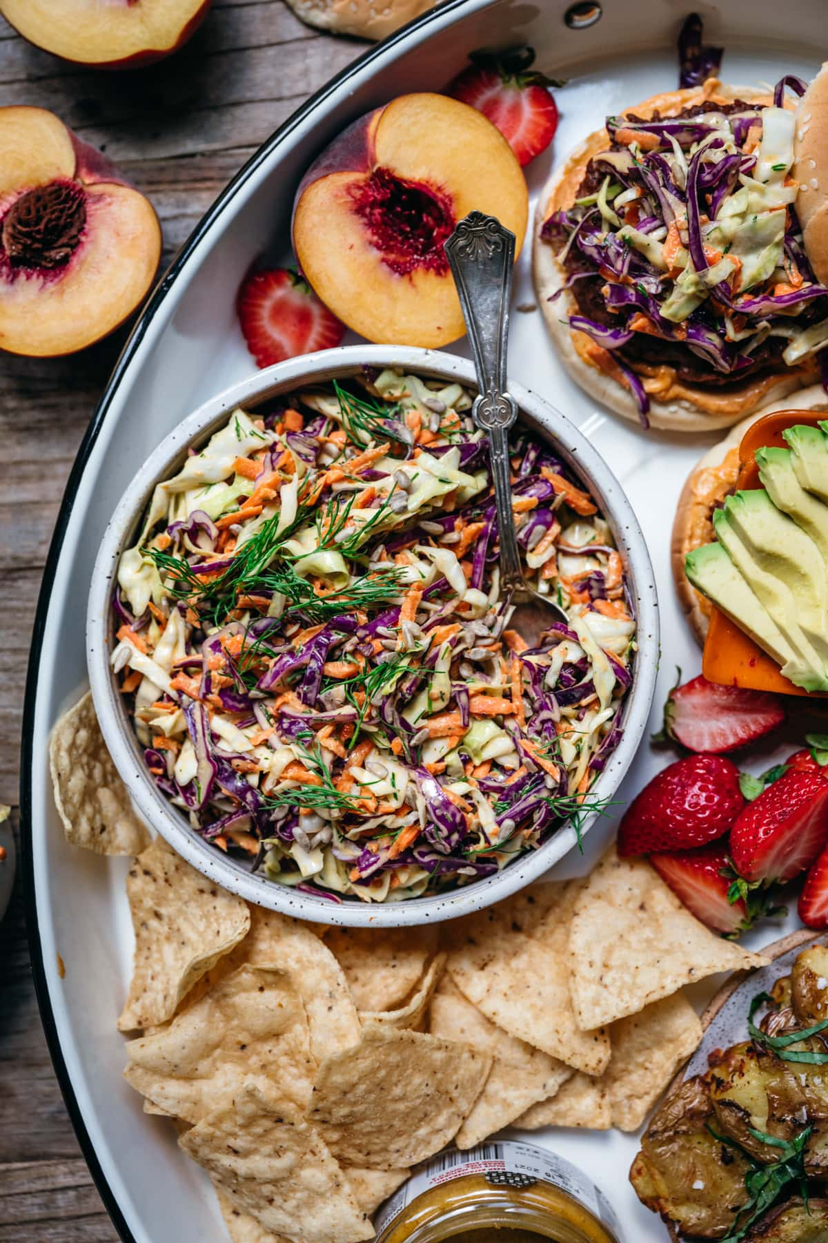 overhead view of classic vegan coleslaw in white bowl.