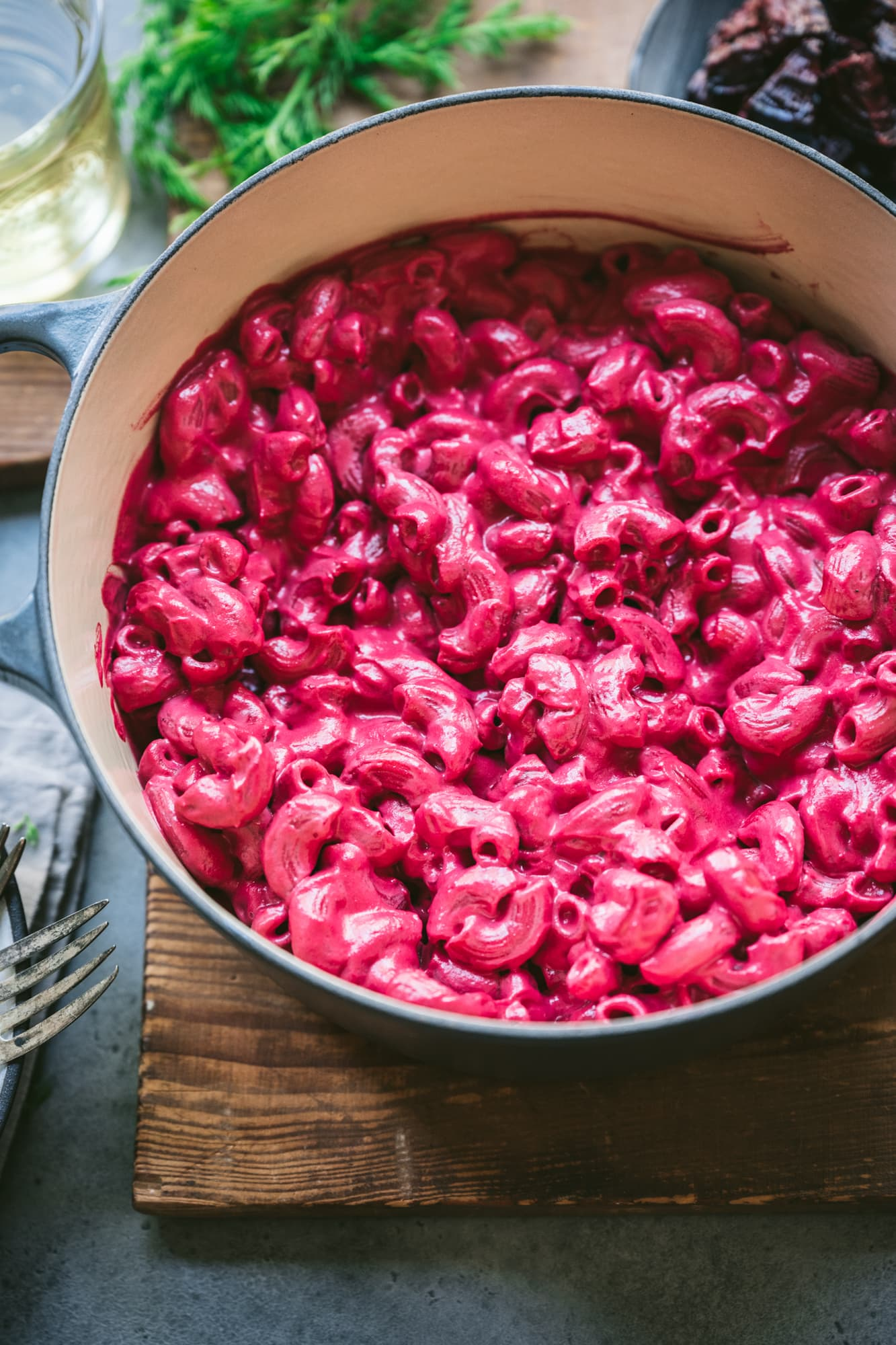 side view of vegan beet pasta in a large pot.