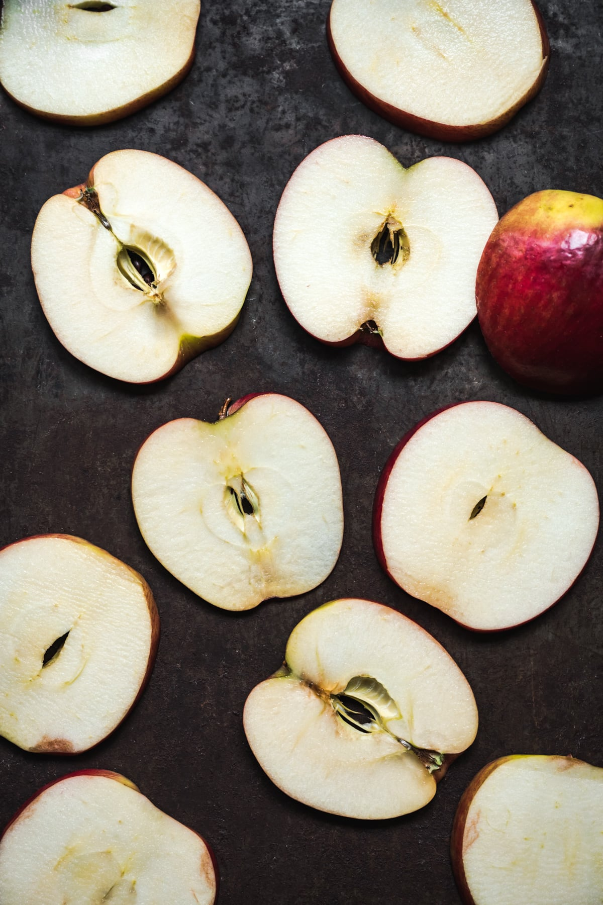 overhead view of apple slices on a sheet pan.