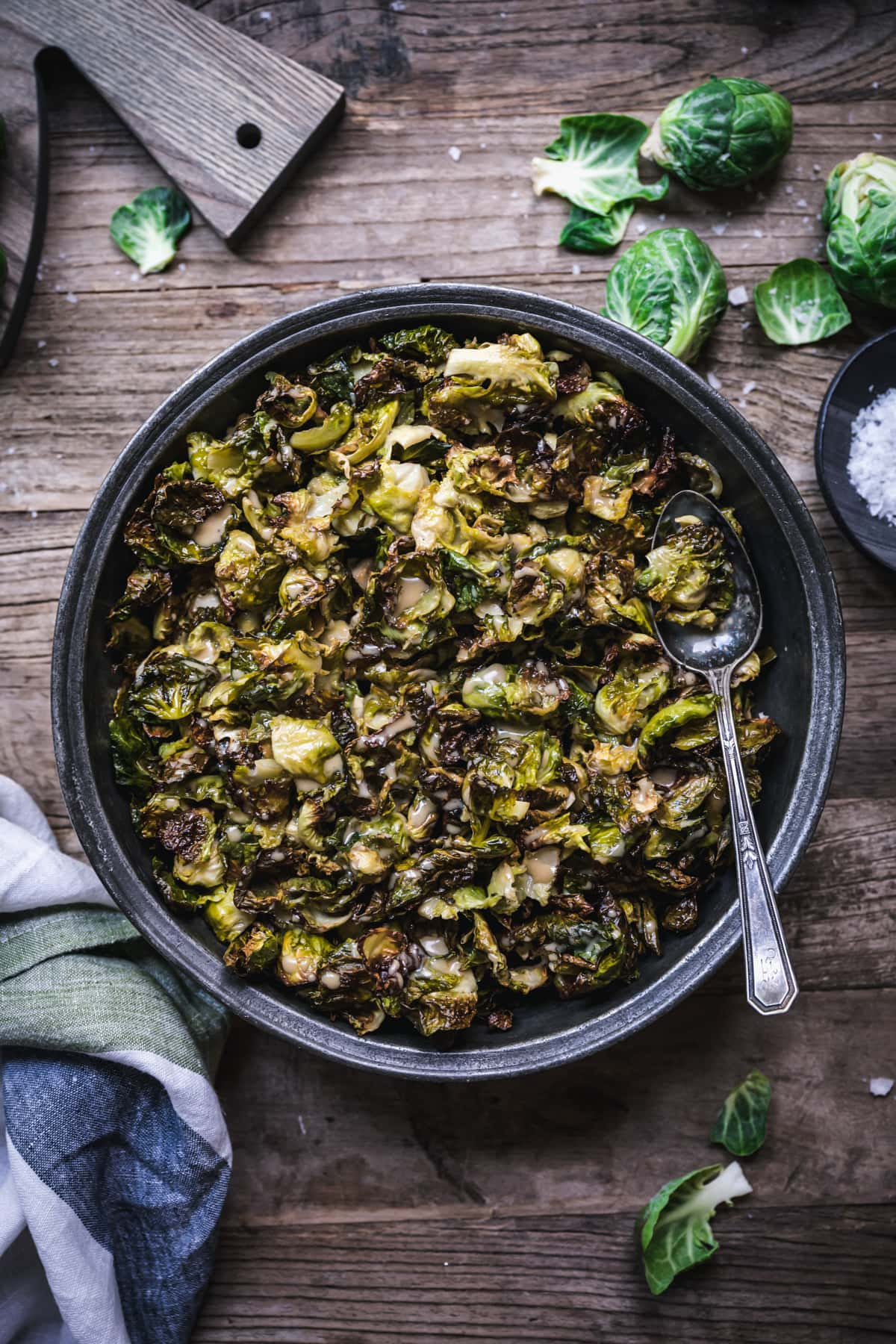 overhead view of a bowl of crispy roasted brussels sprouts with maple mustard dressing.