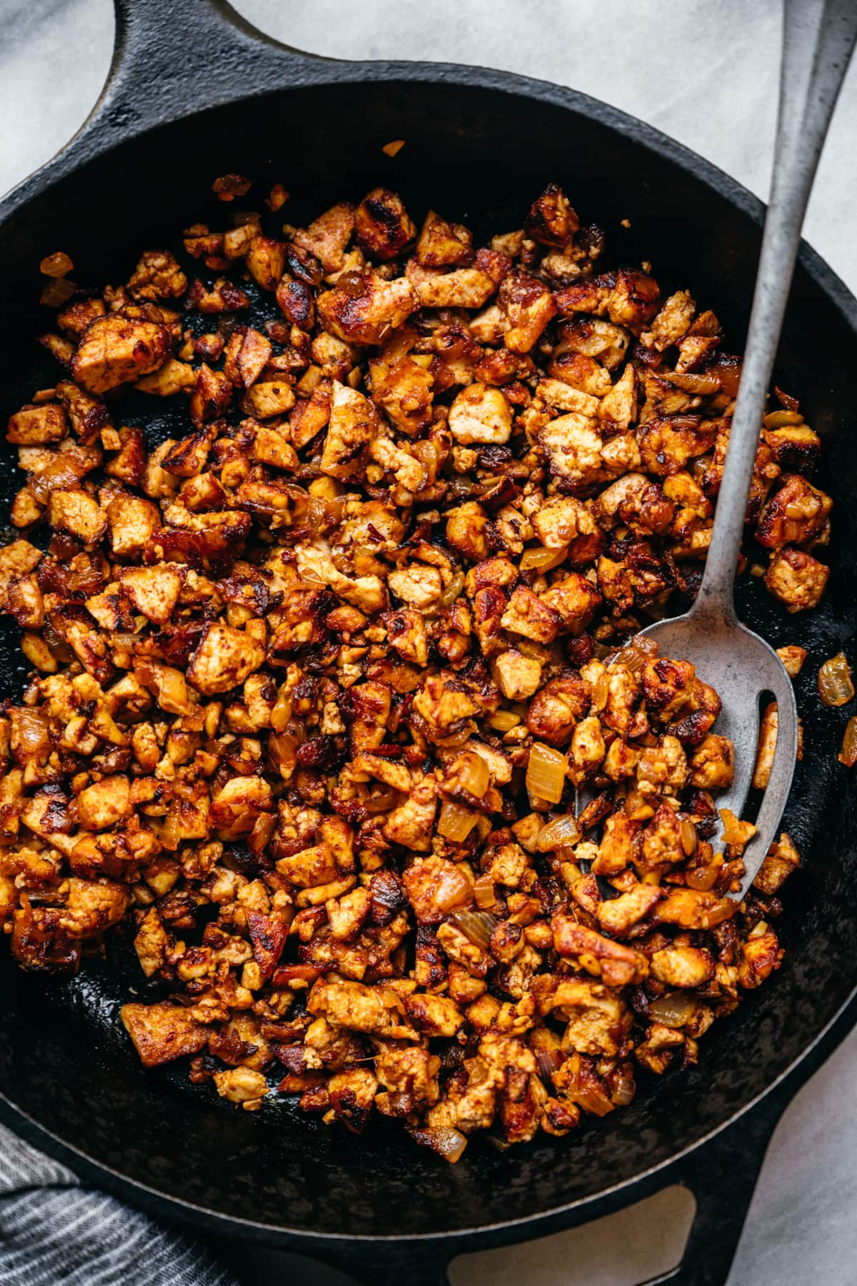 overhead view of crispy sofritas tofu in a cast iron skillet.
