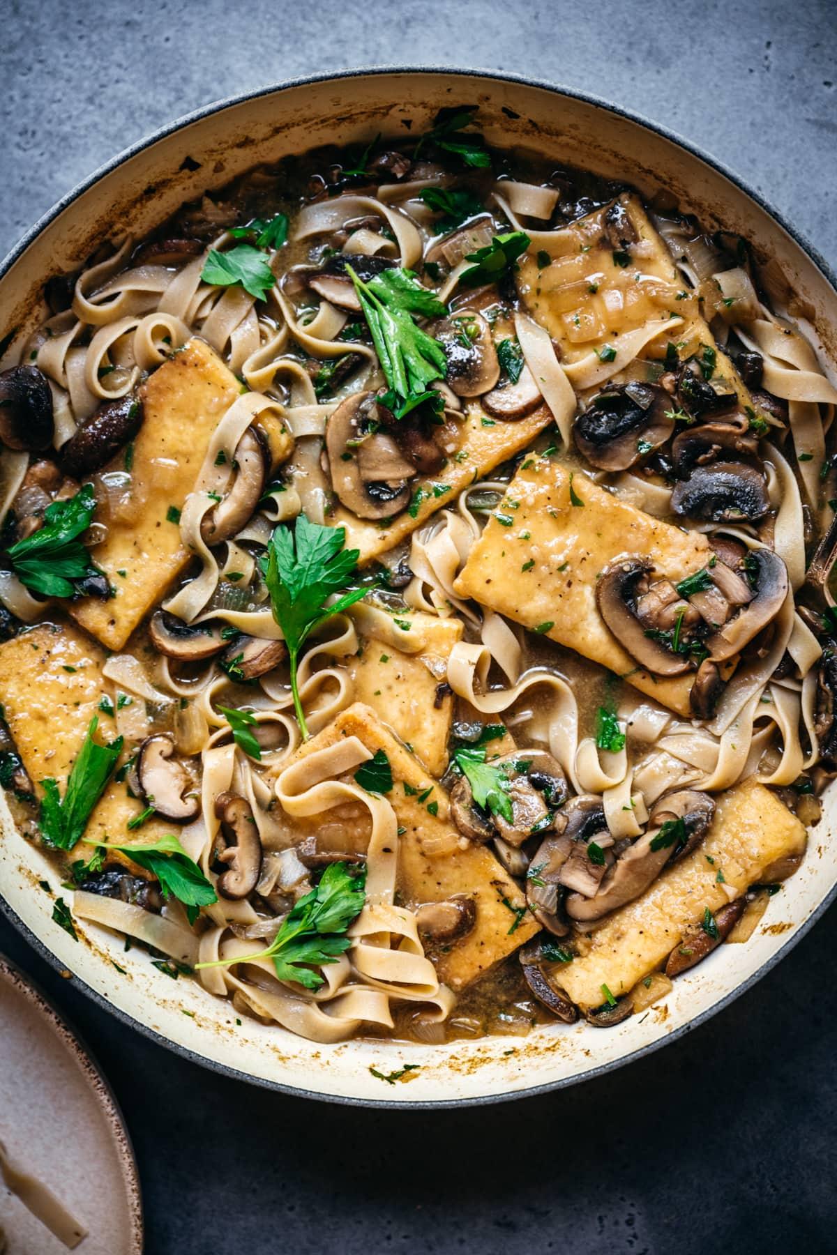 overhead view of vegan tofu marsala in a large pan.