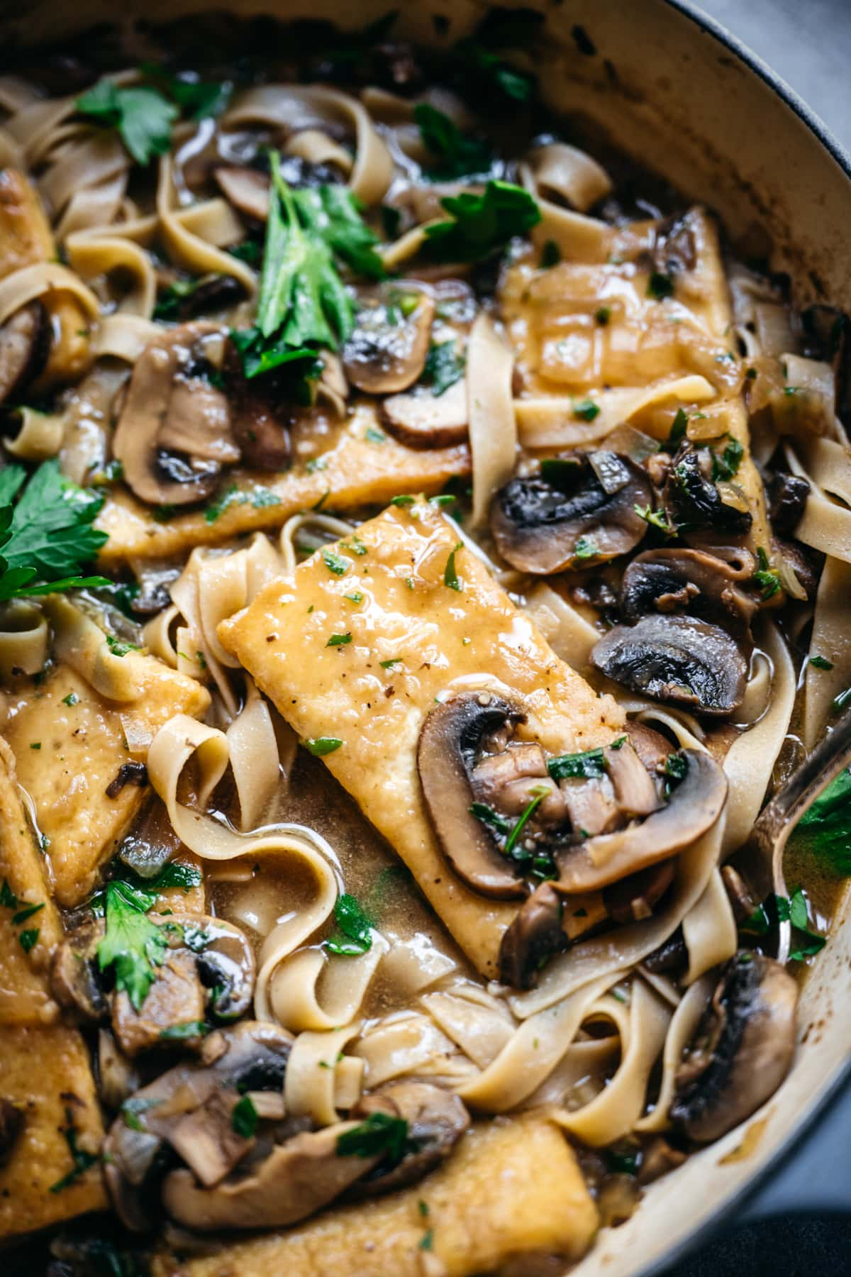 close up view of tofu marsala in a pan.