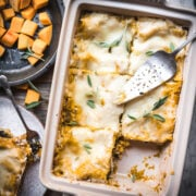 overhead view of pan of vegan butternut squash lasagna cut into slices.