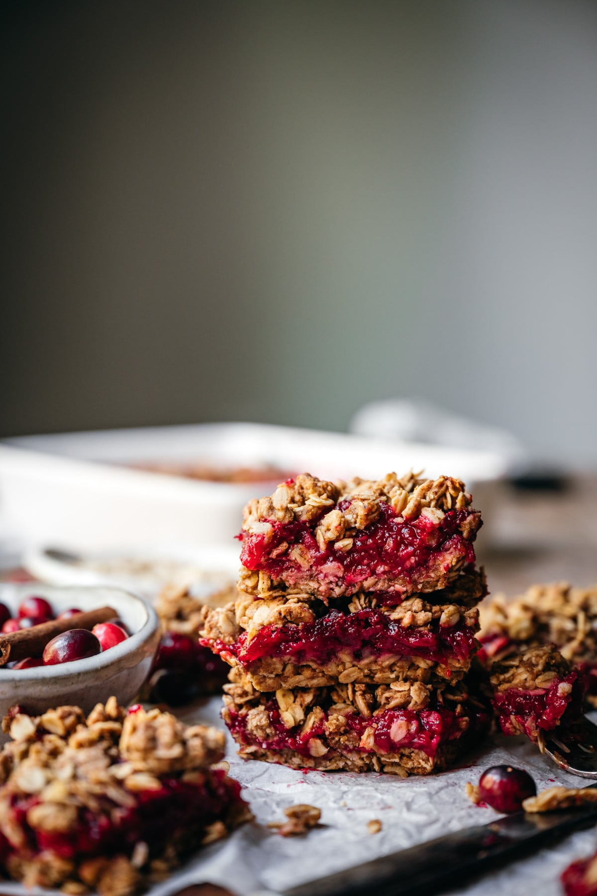 side view of stack of 3 cranberry crumb bars.