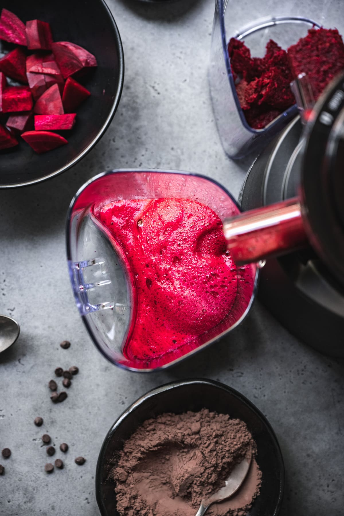 beet juice coming out of juicer.