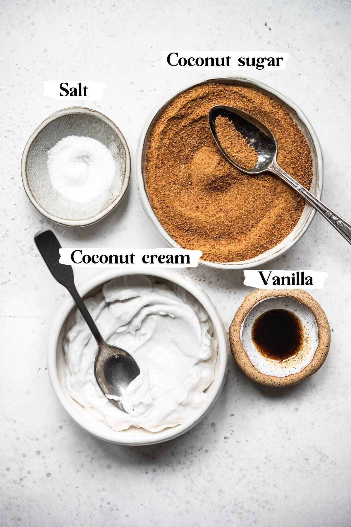 overhead view of ingredients for vegan caramel sauce in bowls.