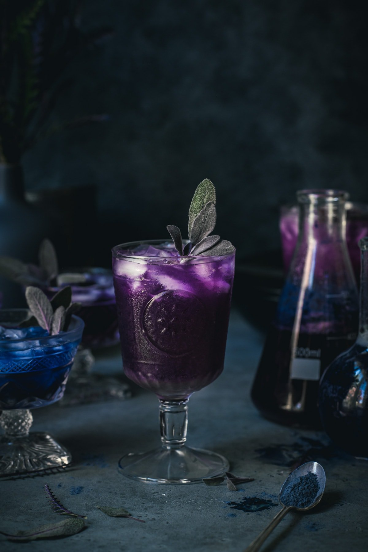side view of a purple polyjuice potion cocktail in a glass.