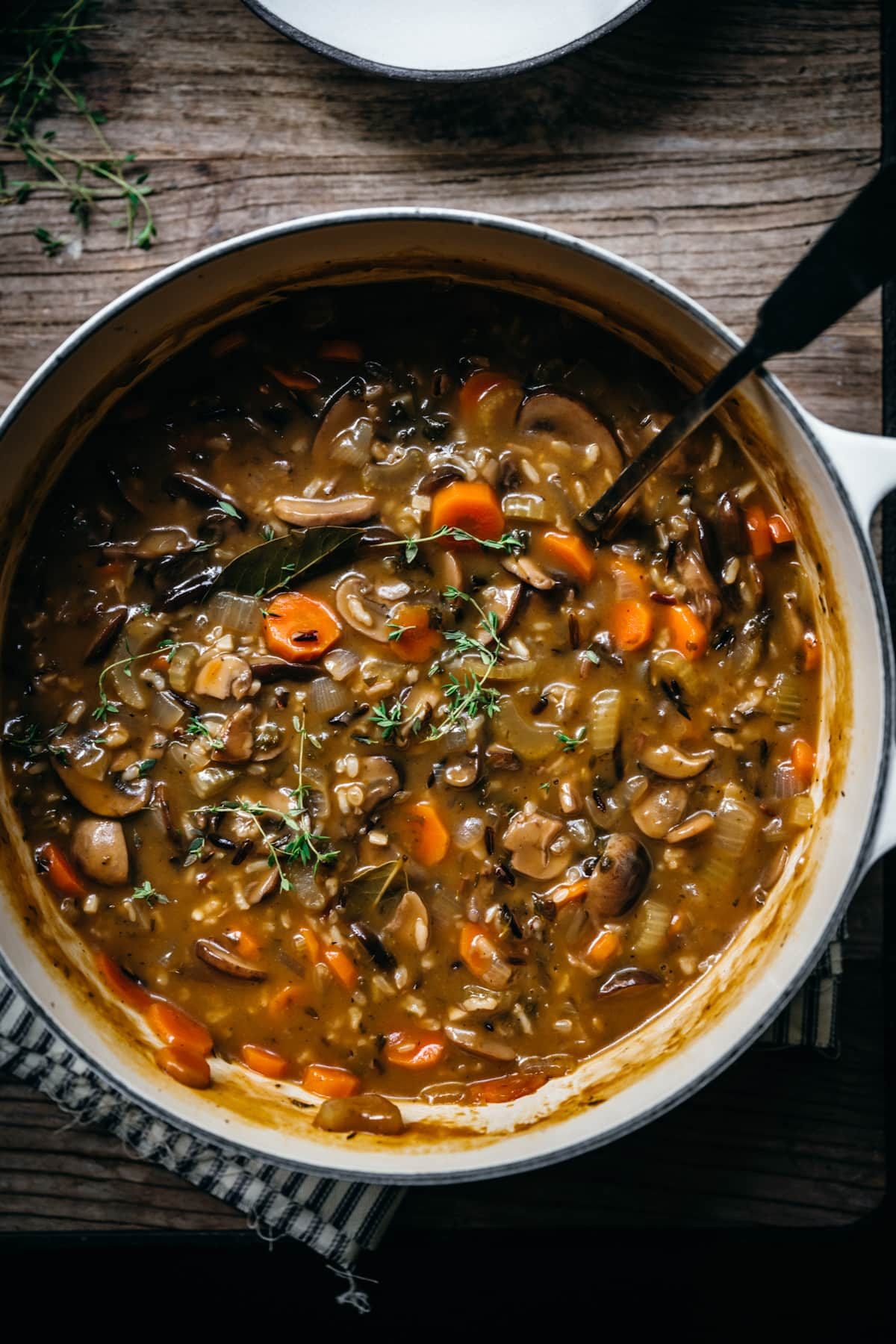 overhead close up view of wild rice mushroom soup in a pot.
