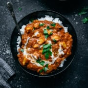 overhead view of vegan tofu tikka masala in a bowl with white rice.