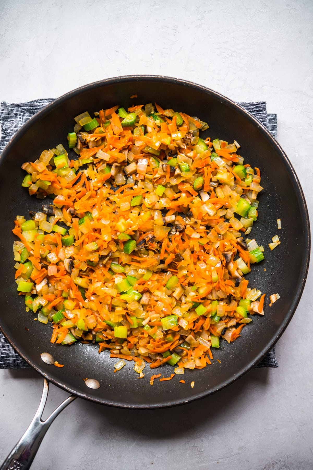 overhead view of sautéed vegetables in a skillet.