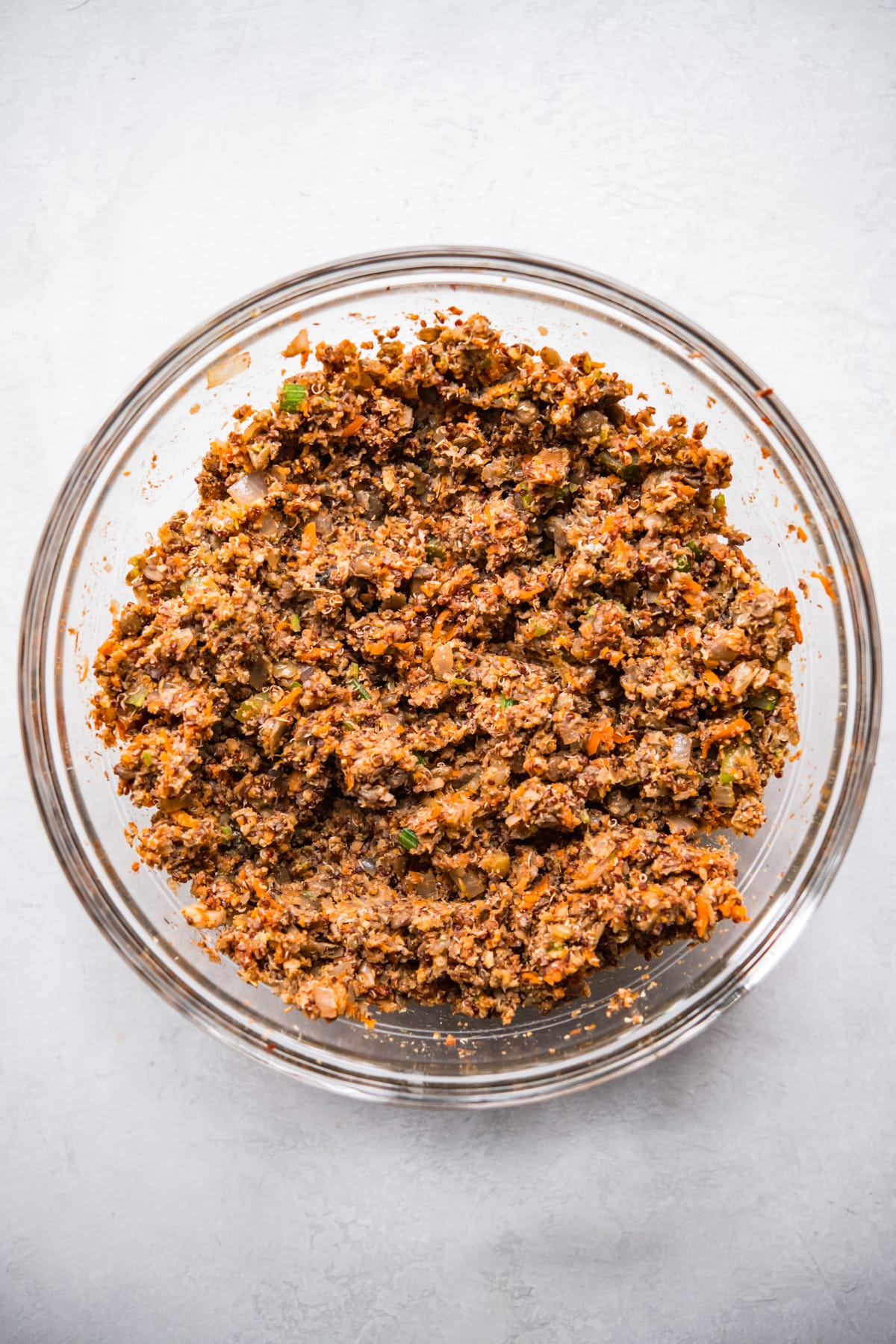 Glass bowl with ingredients for vegan meatloaf, mixed.