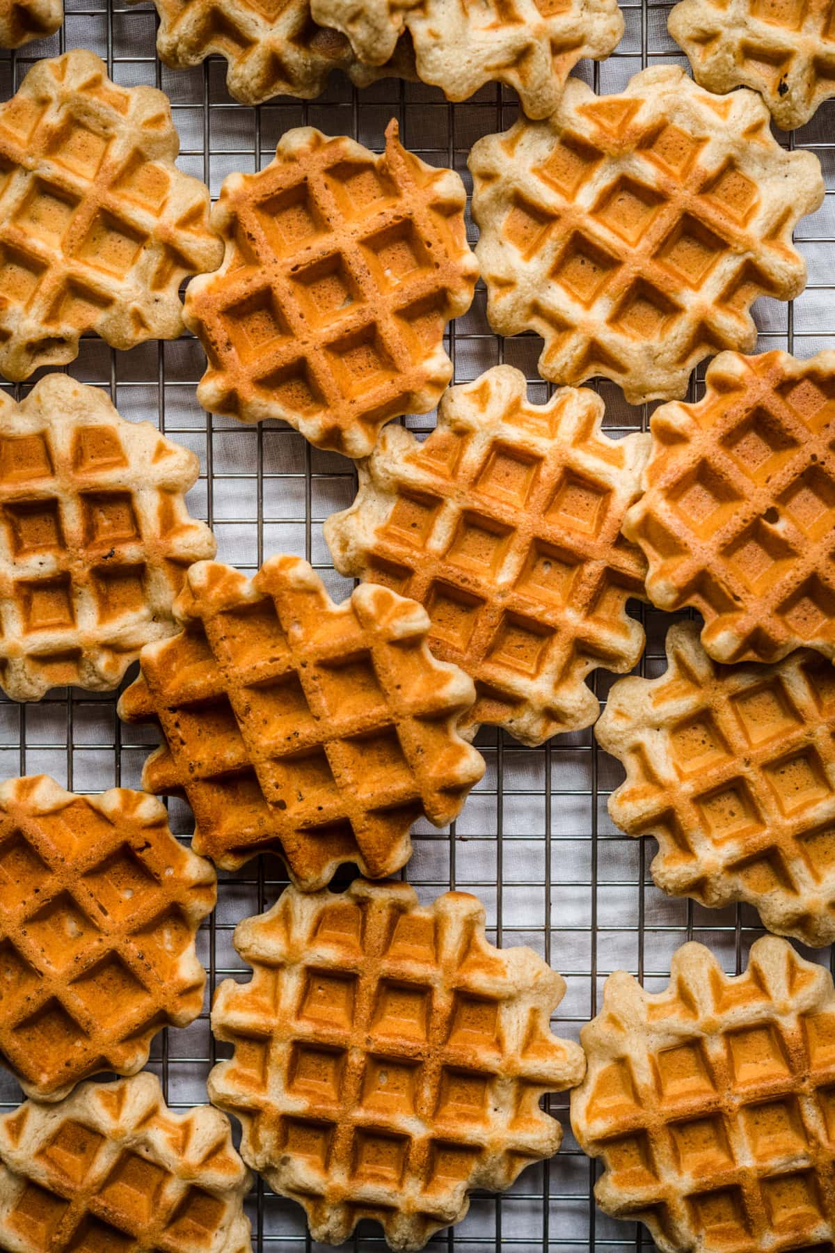 overhead view of homemade waffles on cooling rack.