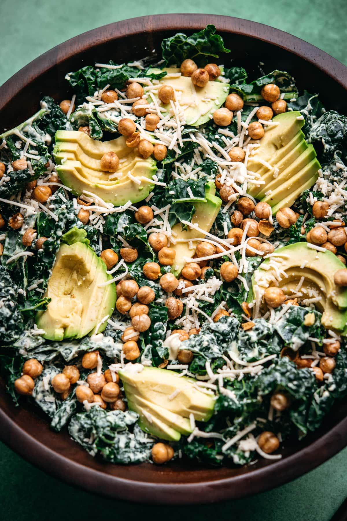 close up view of vegan kale tahini caesar salad with chickpeas.
