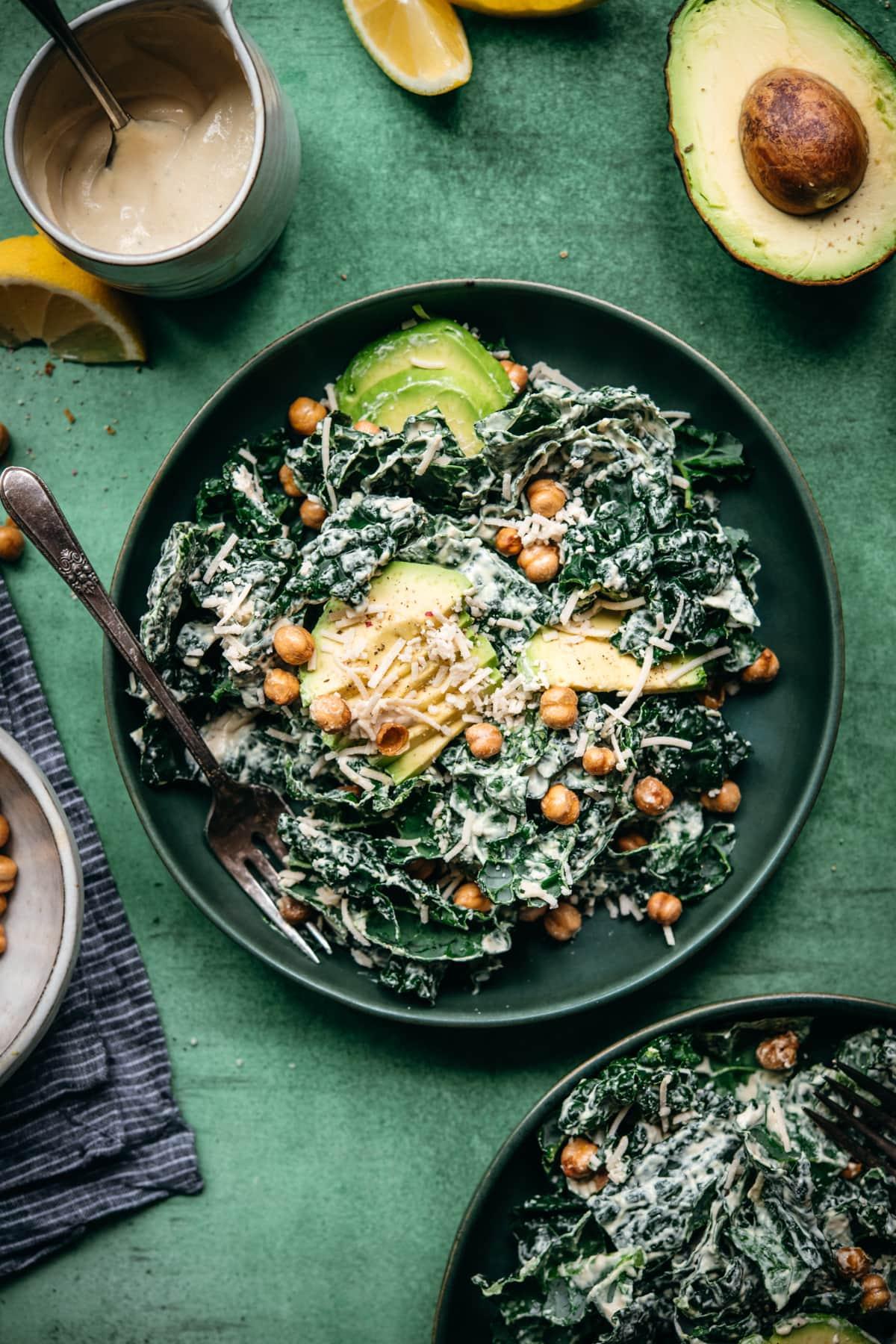 overhead view of vegan tahini caesar salad in a blue salad bowl.