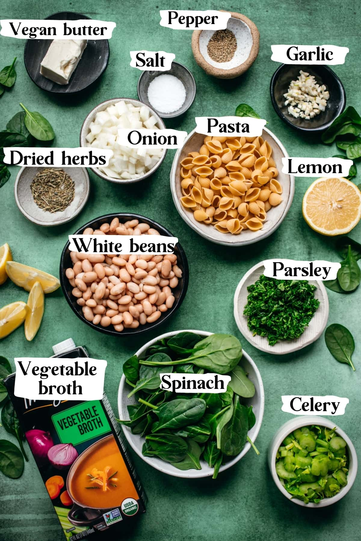 overhead view of ingredients for white bean spinach soup with text labels.