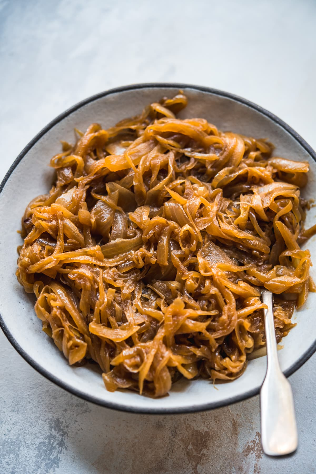 close up of caramelized onions in a bowl.