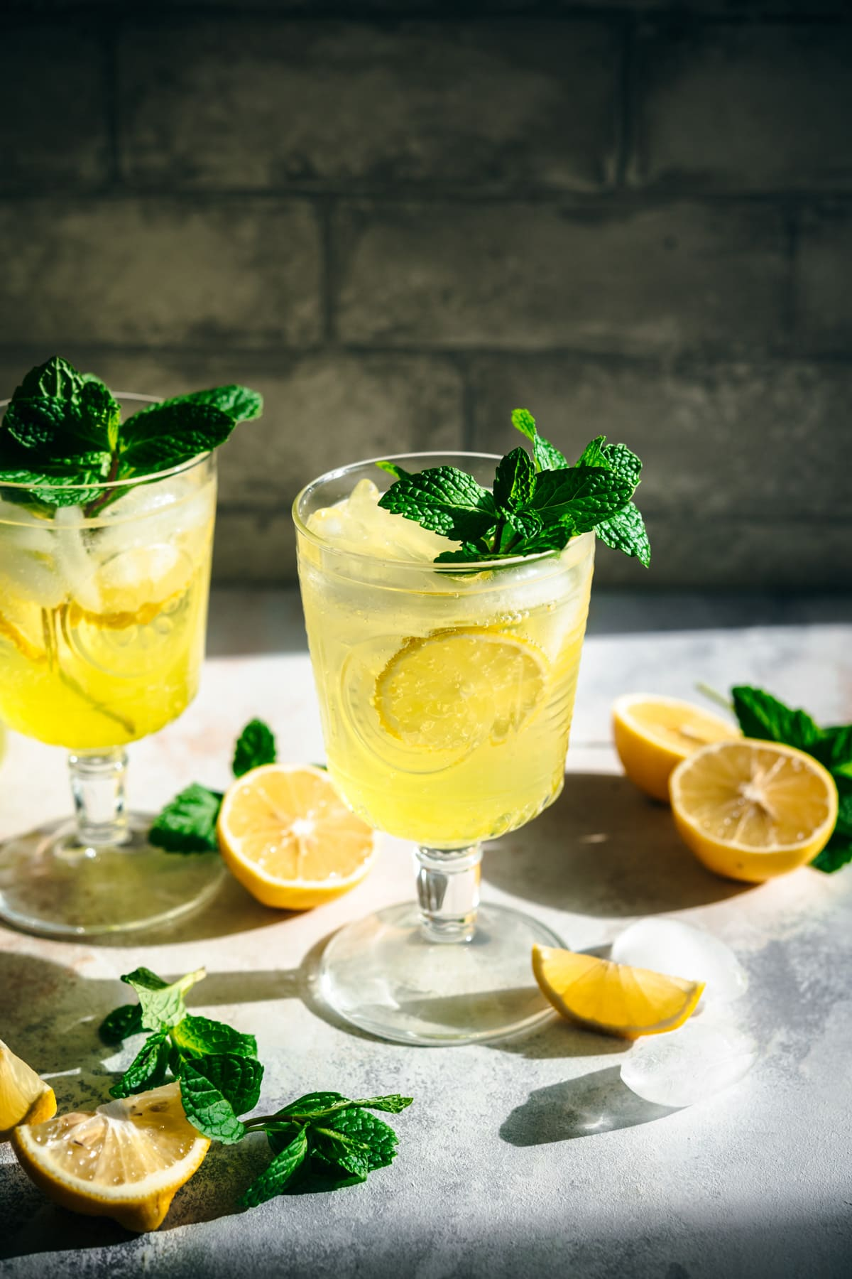 side view of limoncello spritz cocktail garnished with fresh mint.