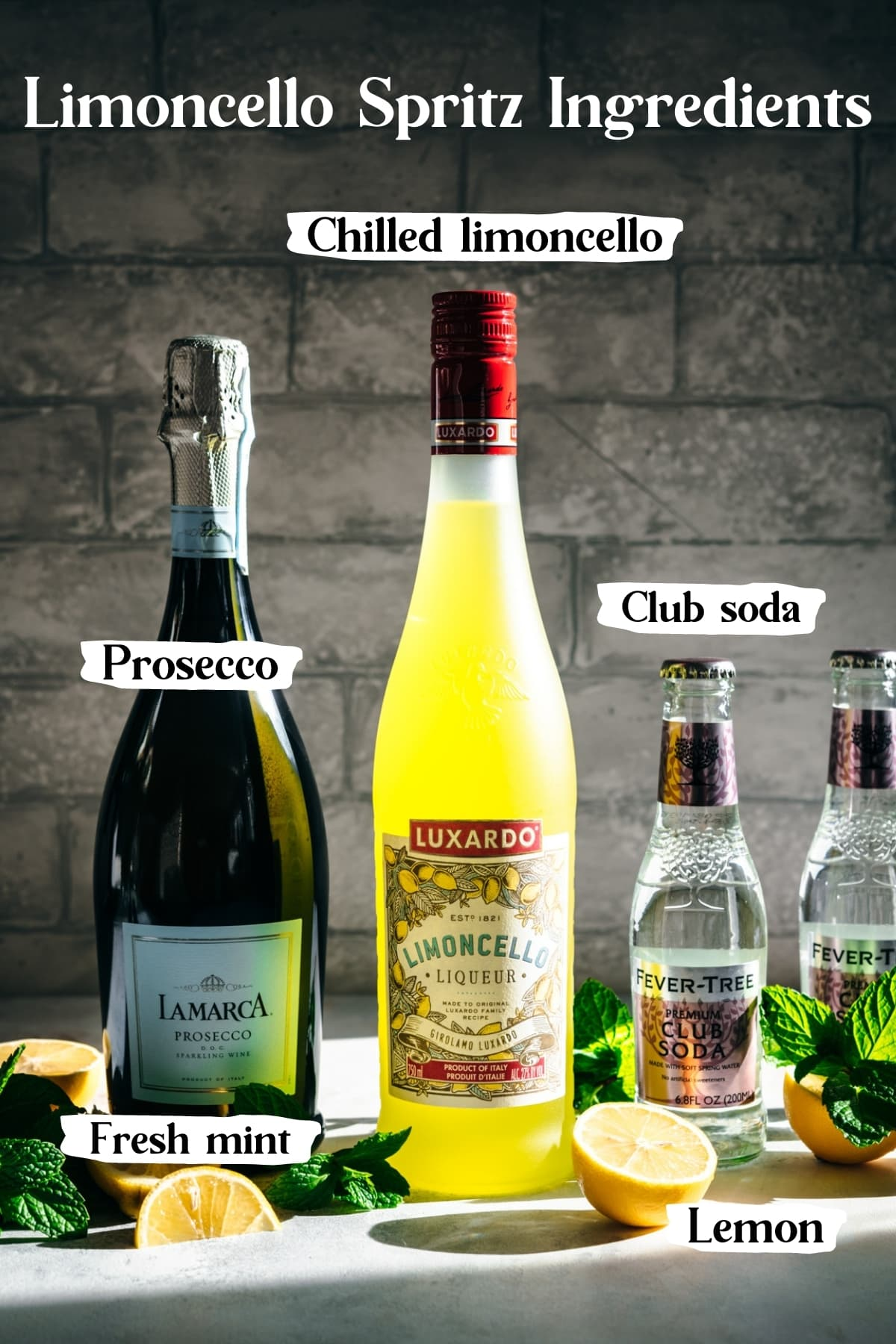 side view of ingredients for limoncello spritz.