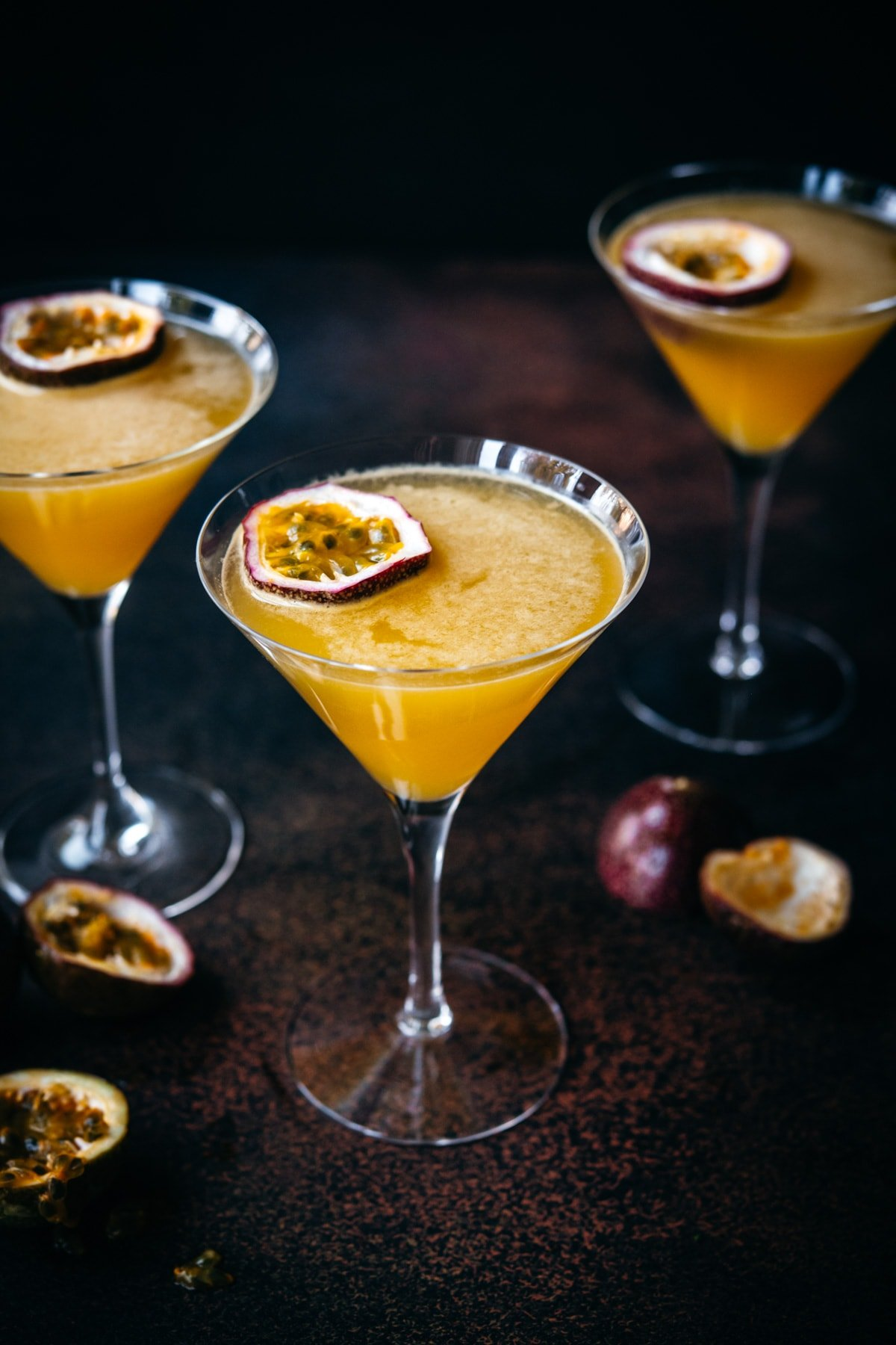 close up view of a passion fruit martinis.