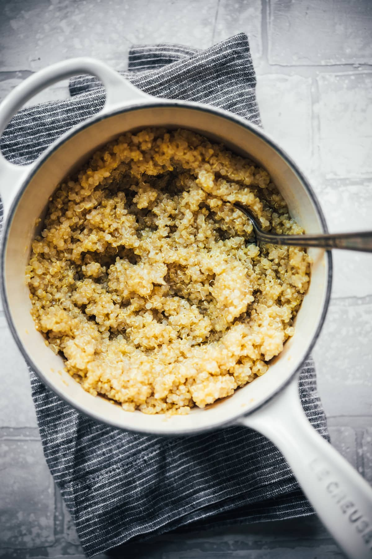 overhead view of cooked quinoa in a small saucepan.