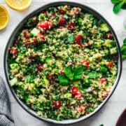 overhead view of vegan quinoa tabbouleh in a salad bowl.