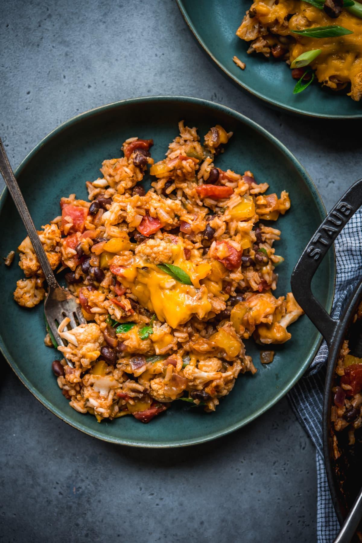 overhead view of vegan cauliflower rice black bean bake on a plate.