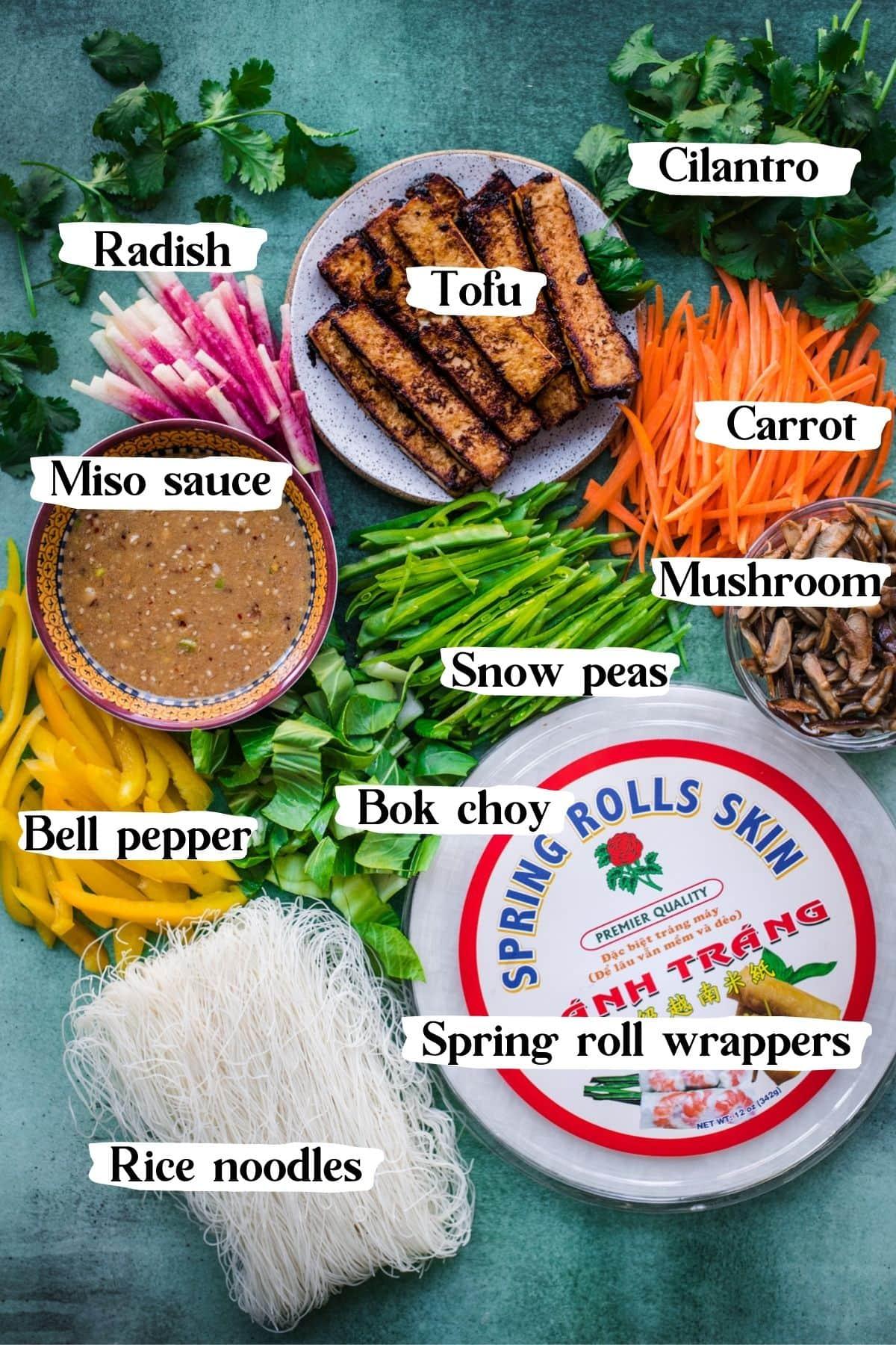 overhead view of ingredients for tofu vegetable vegan summer rolls.