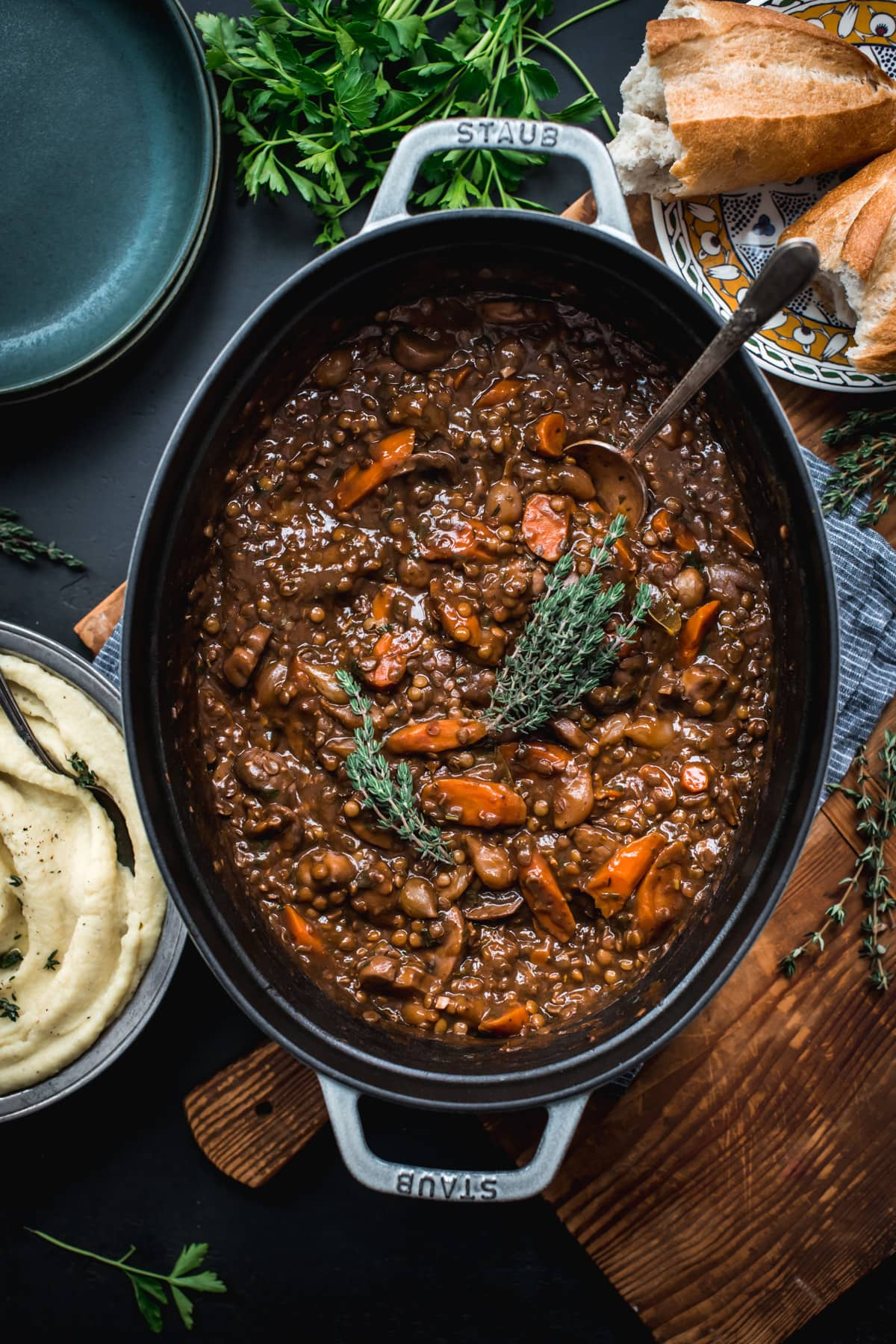 overhead view of vegan lentil and mushrooom coq au vin in a large dutch oven.