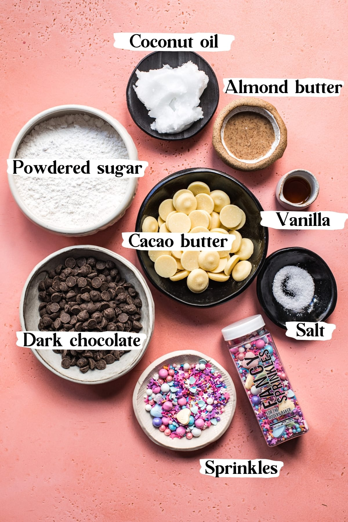 overhead view of ingredients for vegan white chocolate bark, including cacao butter, dark chocolate, coconut oil.