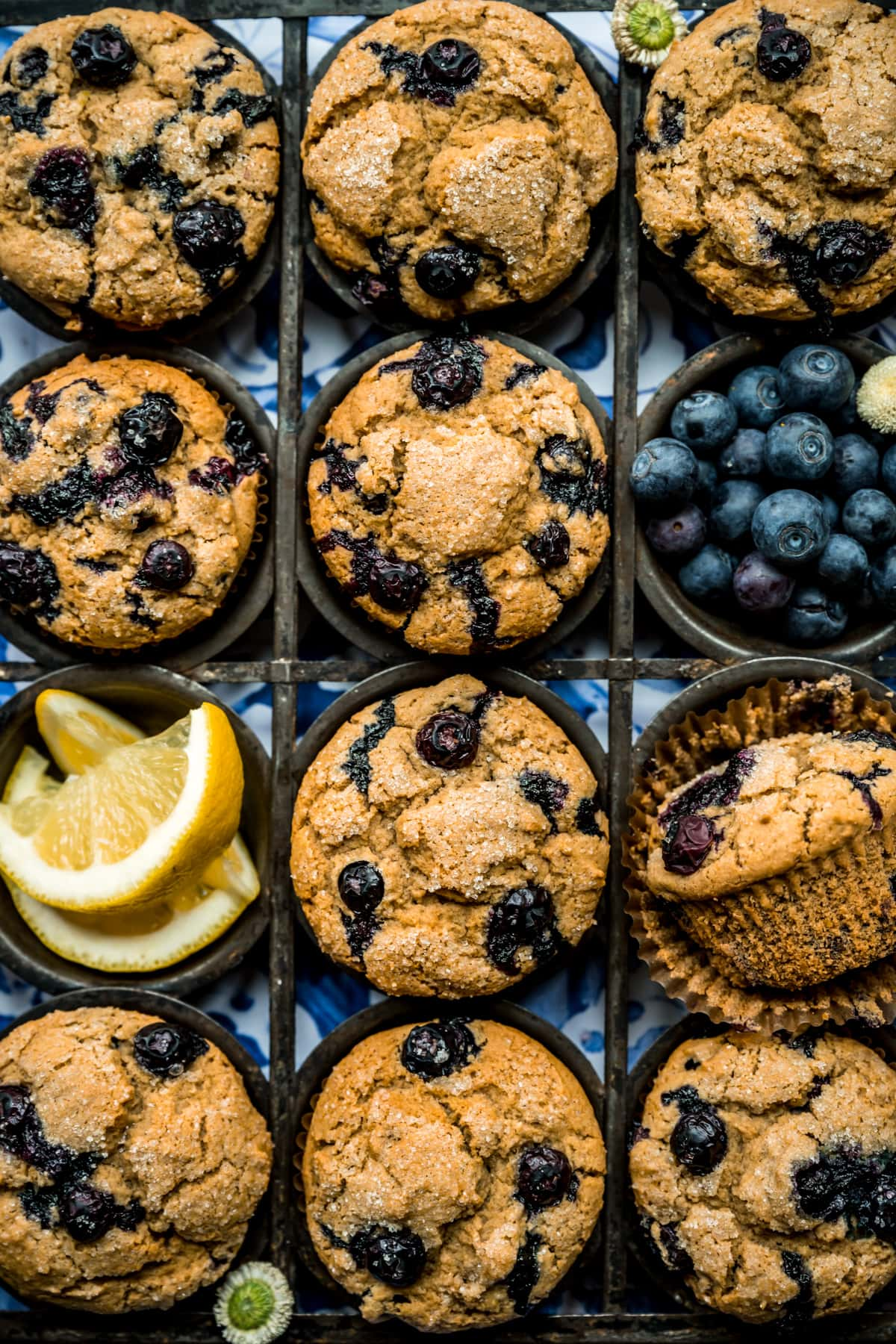 overhead view of vegan blueberry muffins in antique muffin tin.