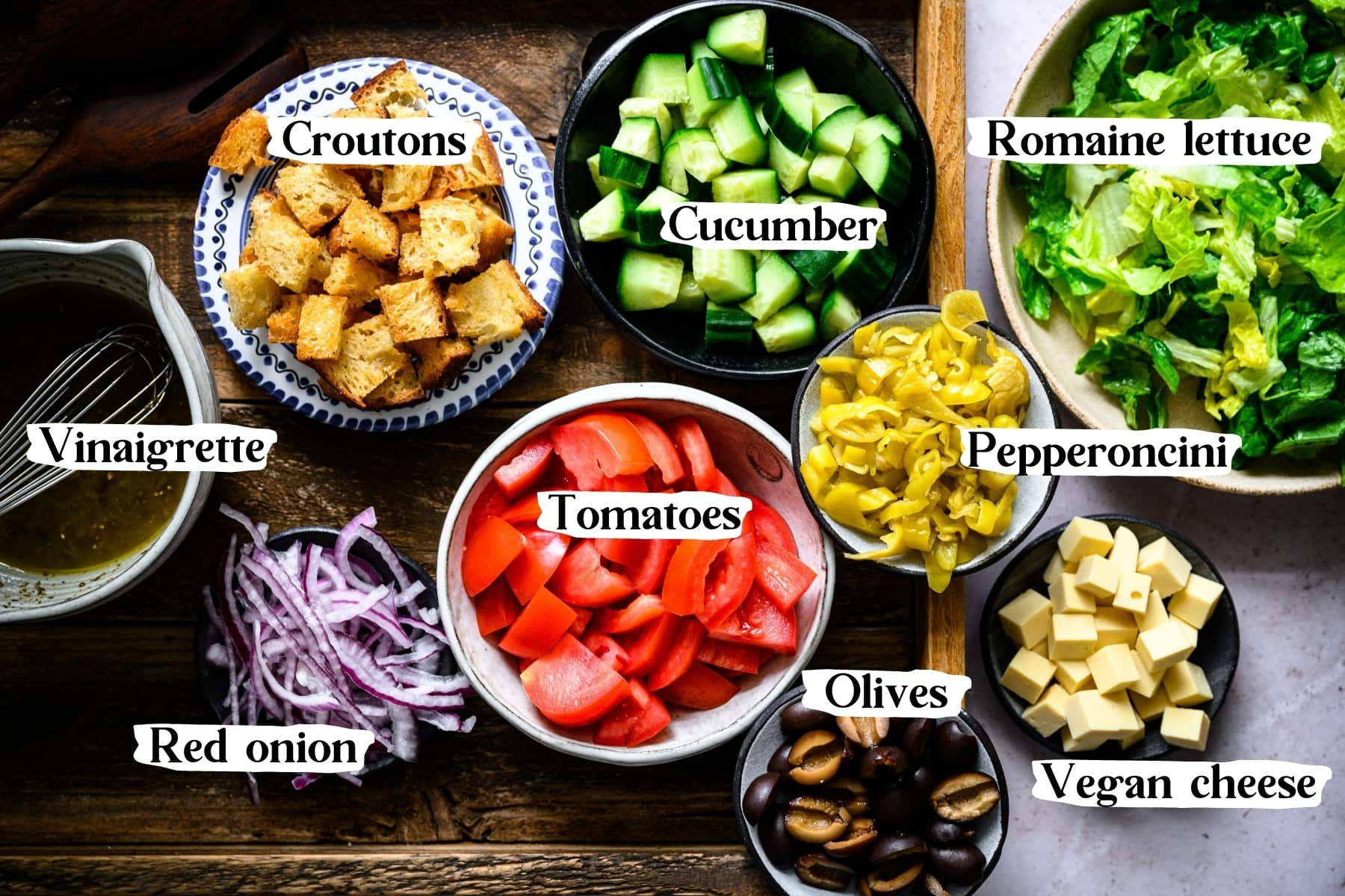 overhead view of ingredients for italian chopped salad in bowls.