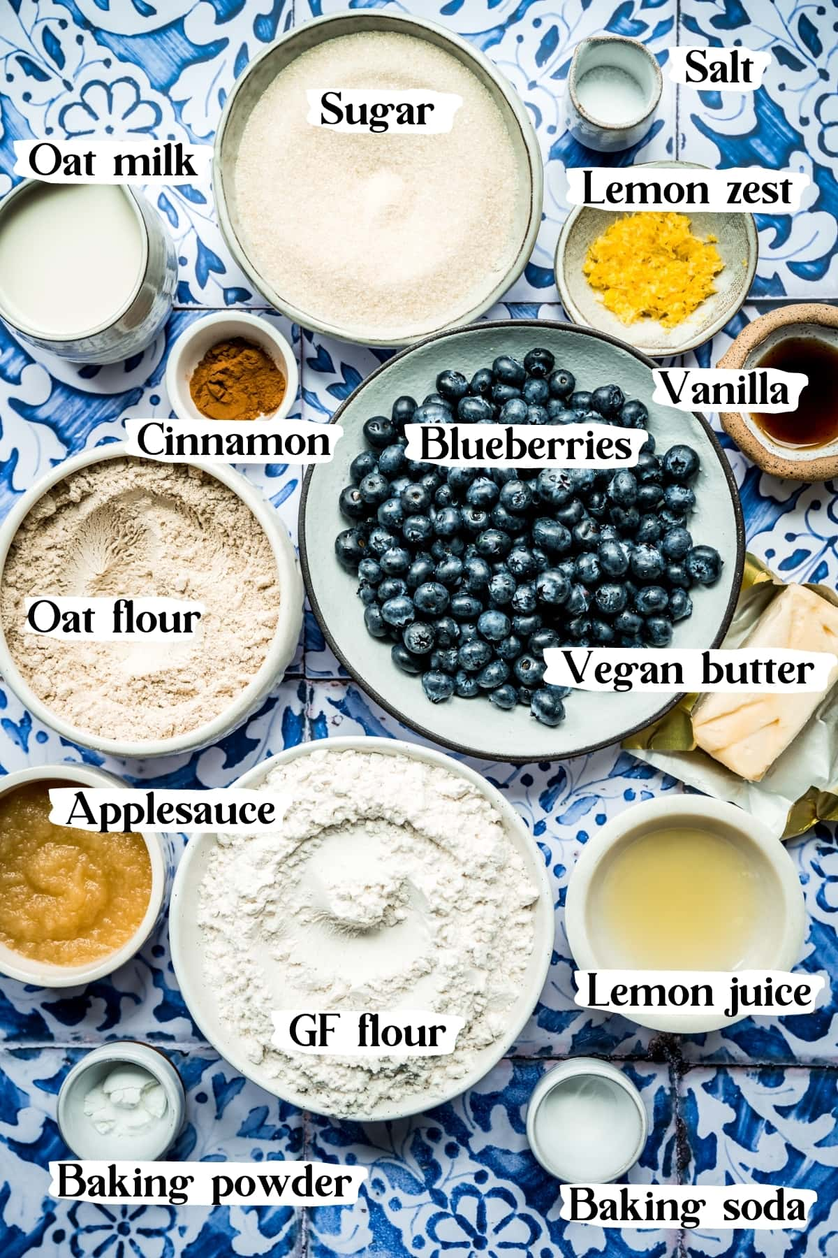 overhead view of ingredients for vegan blueberry muffins in small bowls.