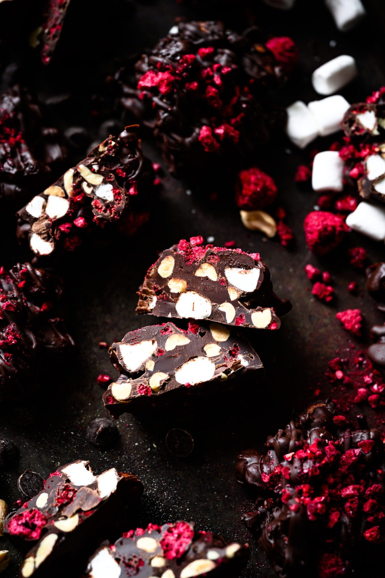 overhead view of vegan chocolate peanut marshmallow clusters with freeze dried raspberries.