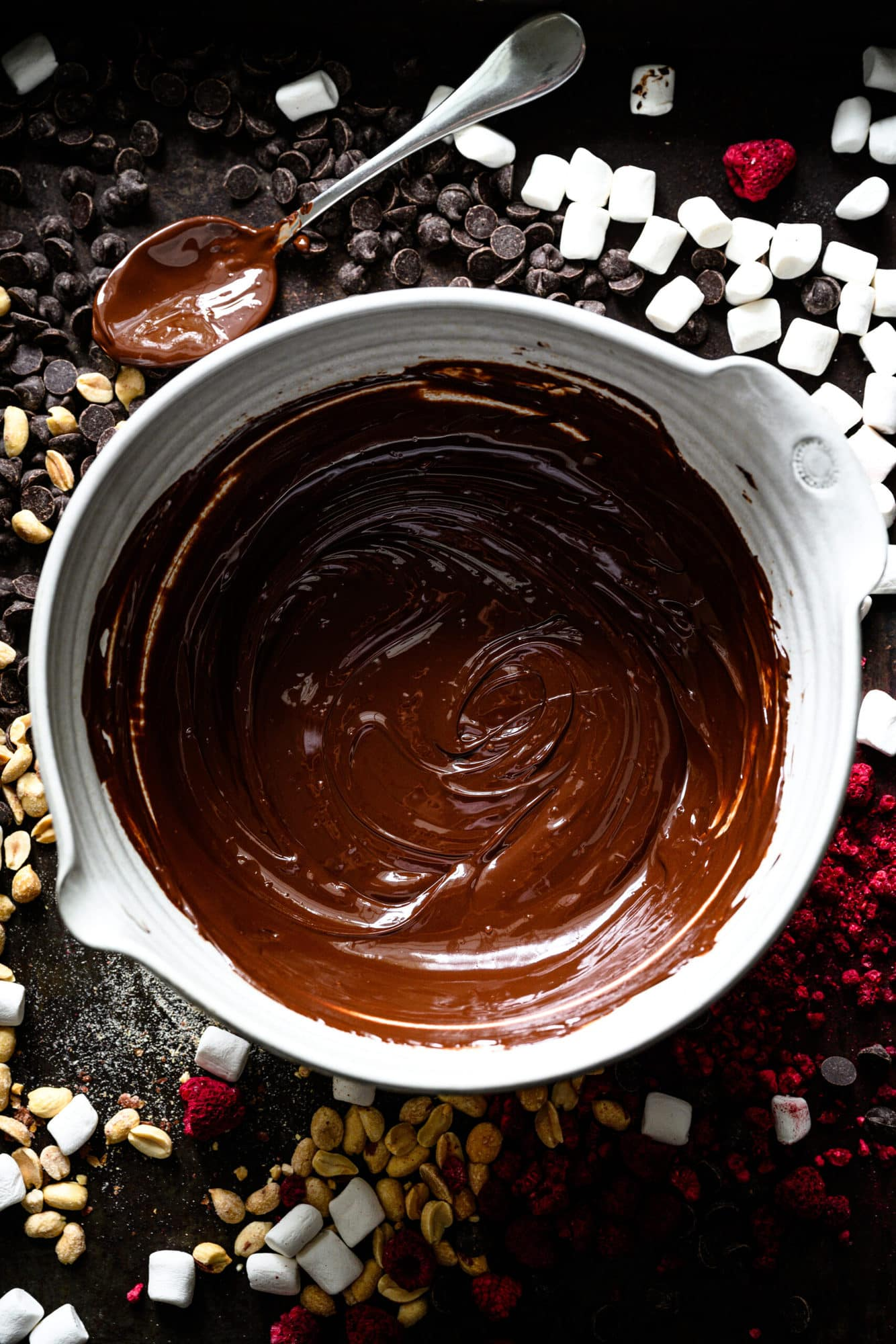 overhead view of melted dark chocolate in a large mixing bowl.