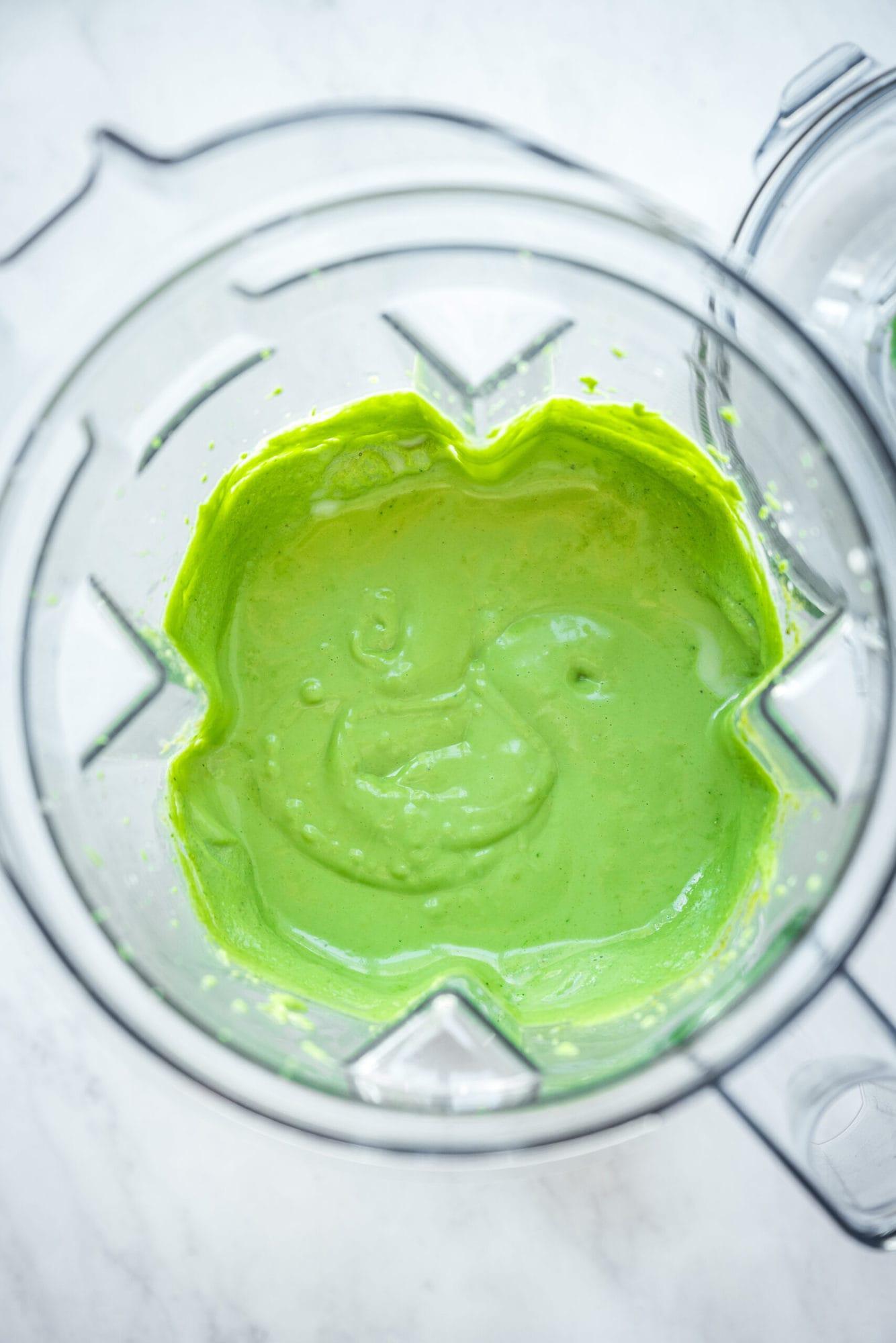 overhead view of green vegan shamrock shake in blender.